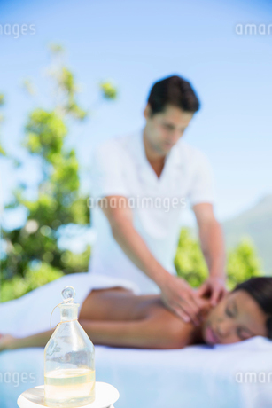 Woman receiving massage on spa patioの写真素材 [FYI02184079]