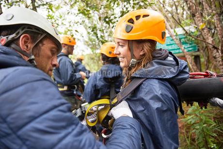 Friends preparing zip line equipmentの写真素材 [FYI02185594]