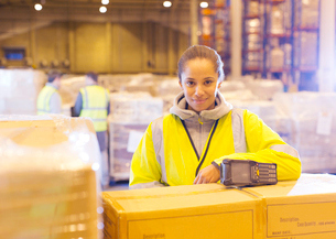 Worker smiling in warehouseの写真素材 [FYI02186296]