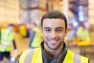 Worker smiling in warehouseの写真素材 [FYI02186472]