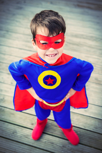 High angle view of superhero boy with hands on hipsの写真素材 [FYI02187357]