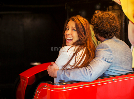 Man embracing scared girlfriend while going into tunnel in ghost trainの写真素材 [FYI02187404]