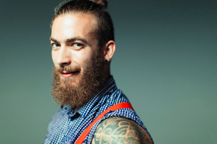 Portrait confident, cool male hipster with beard and shoulder tattooの写真素材 [FYI02187471]