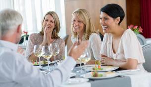 People enjoying meal in restaurantの写真素材 [FYI02187738]