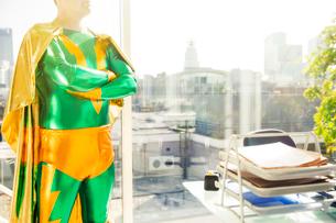 Superhero standing near office deskの写真素材 [FYI02188246]