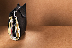 Close up of full wallet standing upright on counterの写真素材 [FYI02188400]