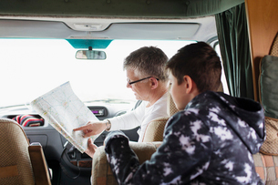 Father and soon looking at map in motor homeの写真素材 [FYI02188498]
