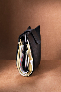 Close up of full wallet standing upright on counterの写真素材 [FYI02188501]