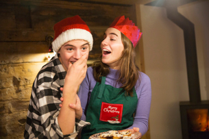 Playful brother and sister eating Christmas cookiesの写真素材 [FYI02188675]