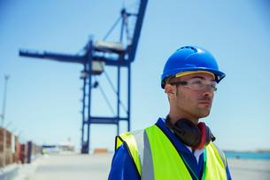 Worker standing near cargo craneの写真素材 [FYI02188913]