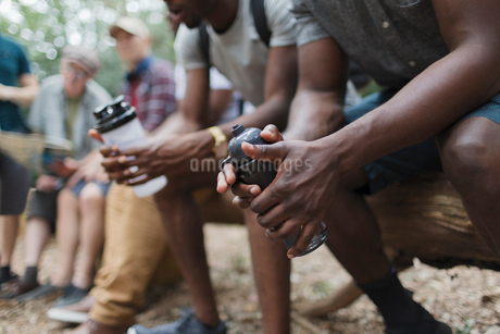 Close up male hikers resting with water bottlesの写真素材 [FYI02189216]