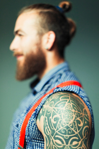 Close up hipster man with shoulder tattoo and beardの写真素材 [FYI02189243]