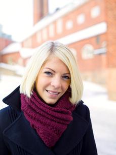 Stockholm, Sweden, Portrait of blonde woman wearing warm cloの写真素材 [FYI02189830]