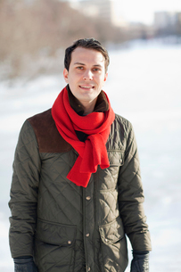 Sweden, Portrait of young man in warm clothingの写真素材 [FYI02190236]