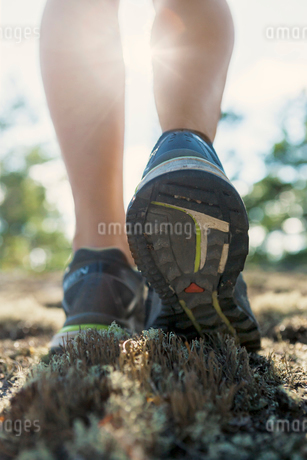 Sweden, Smaland, Close-up view of woman's legs in running shの写真素材 [FYI02192815]