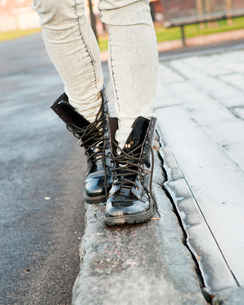 Finland, Helsinki, Young woman wearing work boots, low sectiの写真素材 [FYI02193390]