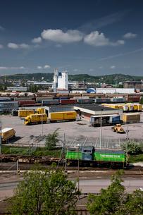 Sweden, Goteborg, Freight train and trucksの写真素材 [FYI02193393]