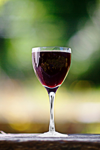 Sweden, Close-up of black currant drink in wine glassの写真素材 [FYI02193449]