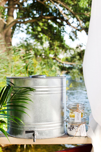 Sweden, Uppland, Metal barrel and jars outdoorsの写真素材 [FYI02193715]