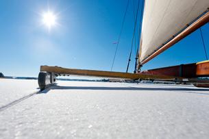 Sweden, Ice sailing across frozen lake, close-upの写真素材 [FYI02193760]