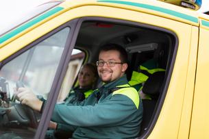 Sweden, Sodermanland, Tumba, Two paramedics in ambulanceの写真素材 [FYI02194205]