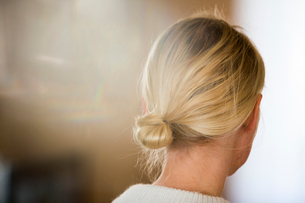 Sweden, Hair bun of blond womanの写真素材 [FYI02194743]
