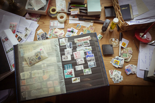 Sweden, Stamp collection on tableの写真素材 [FYI02195018]