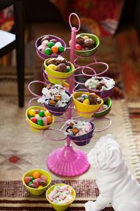 Sweden, Cupcake stand with candyの写真素材 [FYI02195679]