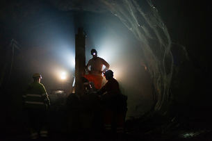Sweden, Norrbotten, Kiruna, Miners working undergroundの写真素材 [FYI02195722]