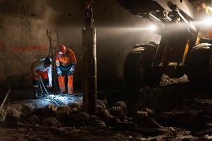 Sweden, Norrbotten, Kiruna, Miners working undergroundの写真素材 [FYI02195984]