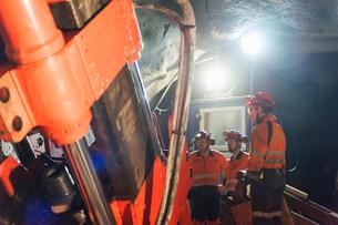 Sweden, Norrbotten, Kiruna, Miners working undergroundの写真素材 [FYI02196243]