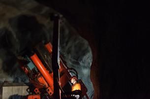 Sweden, Norrbotten, Kiruna, Miner working undergroundの写真素材 [FYI02196248]