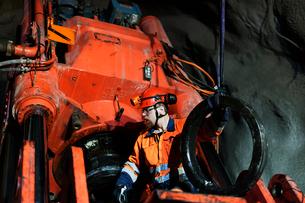 Sweden, Norrbotten, Kiruna, Miner working undergroundの写真素材 [FYI02196257]