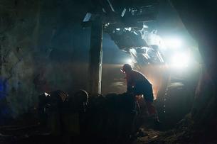 Sweden, Norrbotten, Kiruna, Miner working undergroundの写真素材 [FYI02196335]