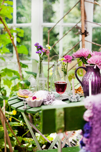 Sweden, Sodermanland, Dessert and red wine on table in gardenの写真素材 [FYI02196439]