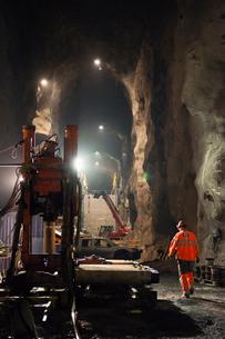 Sweden, Norrbotten, Kiruna, Miner working undergroundの写真素材 [FYI02196627]