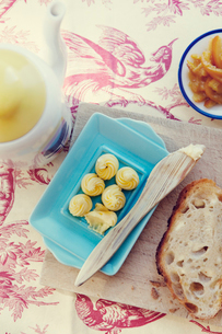 Close up of butter and bread on table clothの写真素材 [FYI02196790]