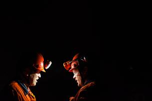 Sweden, Norrbotten, Kiruna, Miners working undergroundの写真素材 [FYI02196853]