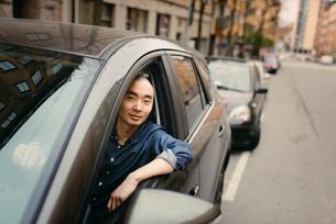 Sweden, Sodermanland, Stockholm, Sodermalm, Young man in carの写真素材 [FYI02196875]