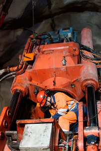 Sweden, Norrbotten, Kiruna, Miner working undergroundの写真素材 [FYI02197015]