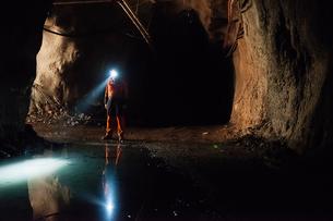 Sweden, Norrbotten, Kiruna, Miner working undergroundの写真素材 [FYI02197099]