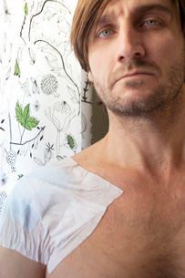 Sweden, Portrait of man with bandage on armの写真素材 [FYI02197310]