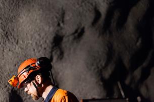 Sweden, Norrbotten, Kiruna, Miner working undergroundの写真素材 [FYI02197571]