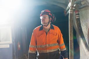Sweden, Norrbotten, Kiruna, Miner working undergroundの写真素材 [FYI02197640]