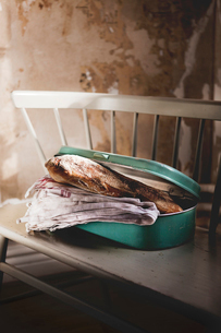 Homemade bread in metal containerの写真素材 [FYI02197787]