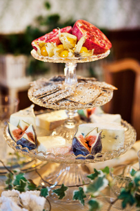 Sweden, Nacka, Sjotorpsvagen, Luxurious dinner, Cake stand with cookies, Fruit and cheeseの写真素材 [FYI02198141]