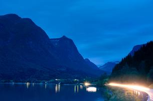 Norway, Sogn og Fjordane, Stryn, Light trails on road and mountain range on backgroundの写真素材 [FYI02198170]