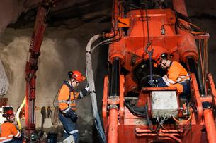 Sweden, Norrbotten, Kiruna, Miners working undergroundの写真素材 [FYI02198239]