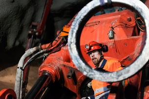 Sweden, Norrbotten, Kiruna, Miner working undergroundの写真素材 [FYI02198341]