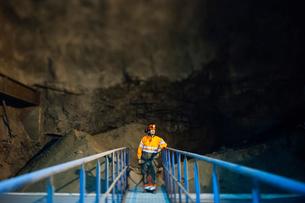 Sweden, Norrbotten, Kiruna, Miner working undergroundの写真素材 [FYI02198364]
